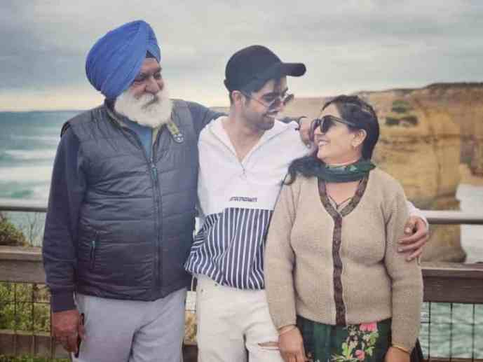 Hardy sandhu with his parents