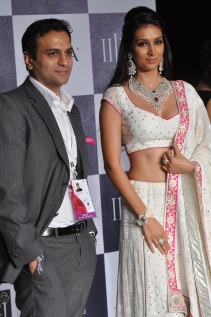 45 Rahuul Jashnani (MD - Cheif Designer JAHN) & Showstopper Preety Desai posing for photo opps at IIJW 2012