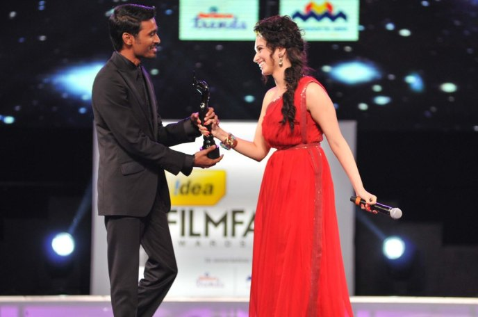 Dhanush receives the Best Actor - Male award for the movie 3 from Tamannaah during the 60th Filmfare Awards