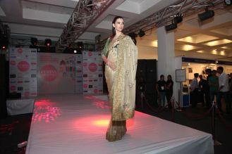 Model walking the ramp at fashion show at the 'Femina Carnival 2013' at Hyatt Regency, Pune.