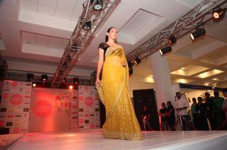 Model walking the ramp at fashion show at the 'Femina Carnival 2013' at Hyatt Regency, Pune