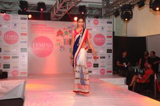 Model walking the ramp at fashion show at the 'Femina Carnival 2013' at Hyatt Regency, Pune..