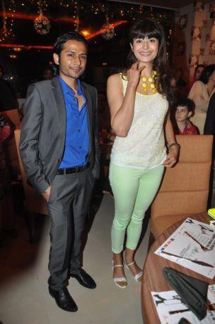 Pooja Batra with Roman Sen posing at the launch of Yoko Sizzlers.