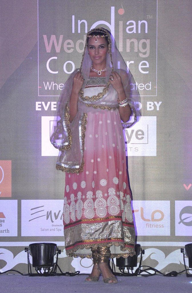 Neha Dhupia walked as showstopper at the finale show of 'Indian Wedding Couture'.1