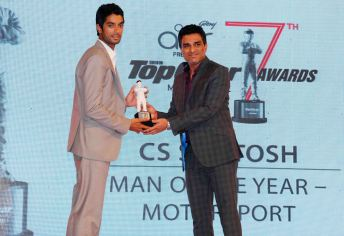 Celebrity Cricketer Sanjay Manjrekar presenting Man of the Year (Motorsports) to CS Santosh at the 7th TopGear Awards