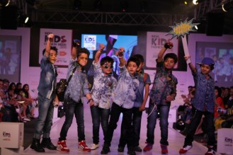 Children walk the ramp for Oks Boys on second day of IKFW 2015