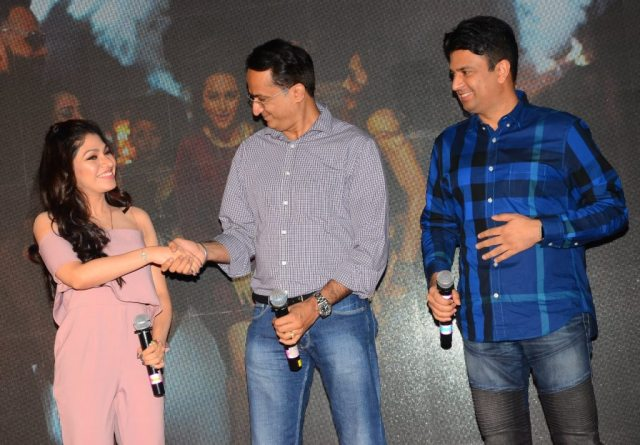 Tulsi Kumar with producers Vikram Malhotra and Bhushan Kumar