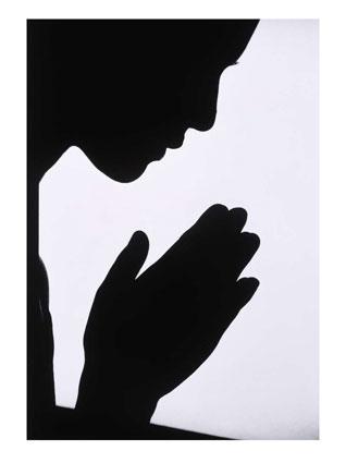 woman-praying-silhouette