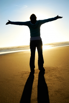 person-extending-arms-in-gratitude-on-the-beach