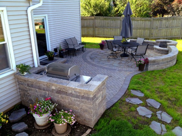 paver patio with fire pit design ideas Should I Use Concrete or Pavers for My Chicagoland Patio? | Archadeck Outdoor Living