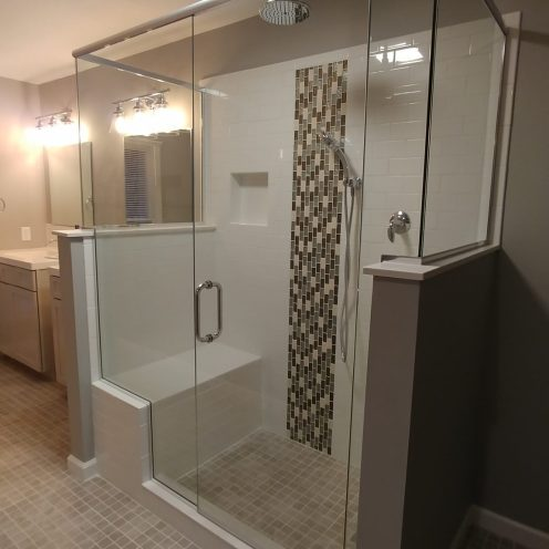 shower with decorative tiles