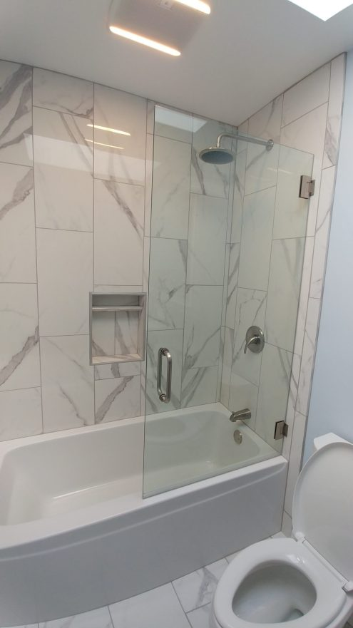 shower/tub with streaked tiles