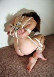 Beautiful Brunette Gets Tightly Bound by Her Husband for Punishment