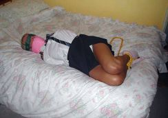 Cute Blond Schoolgirl Bound, Blindfolded and Tape Gagged on Bed