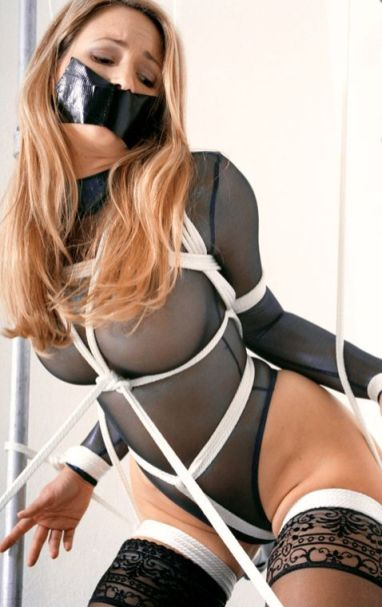 Gorgeous Young Blonde in Stockings Gets Tape Gagged and Tightly Bound