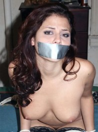 Gorgeous Young Brunette in Stockings Gets Bound and Tape Gagged