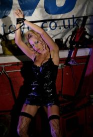 Hot Blonde in PVC and Fishnet Stockings Gets Tape Bound and Punished
