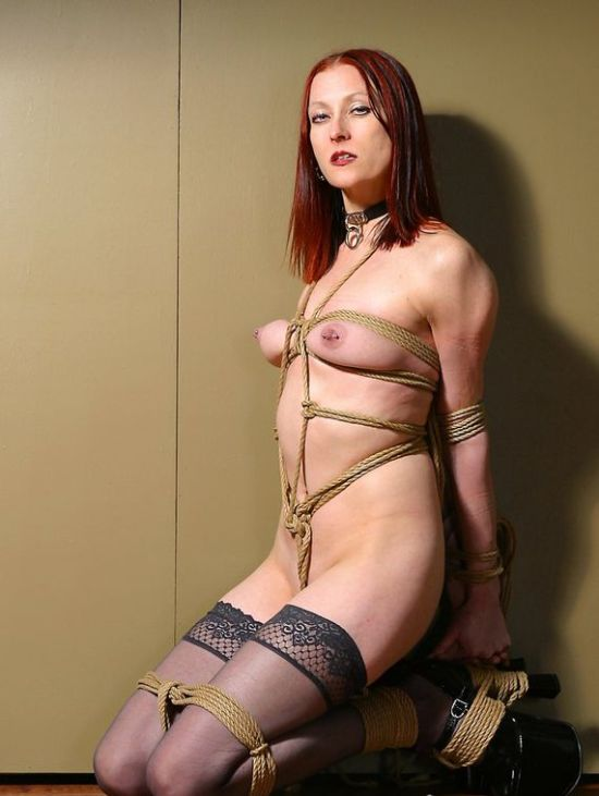 Hot Redhead in Stockings and High Heels Gets Tightly Bound