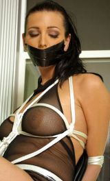 Hot Young Brunette in High Heels Gets Tape Gagged and Tightly Bound