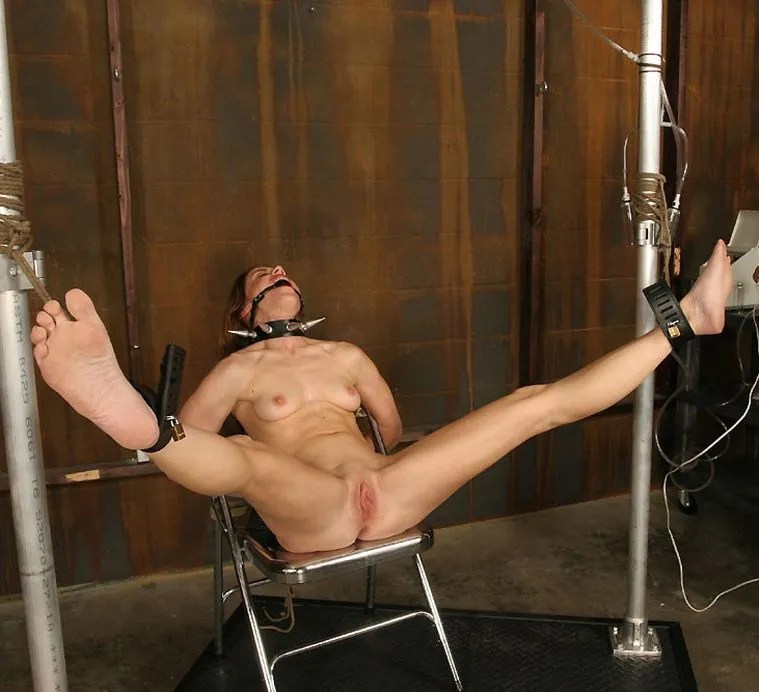 Kinky Young Brunette Restrained, Gagged and Tortured in the Dungeon