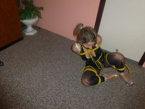 Pretty Blonde in Heels Gets Hogtied and Tape Gagged for Punishment