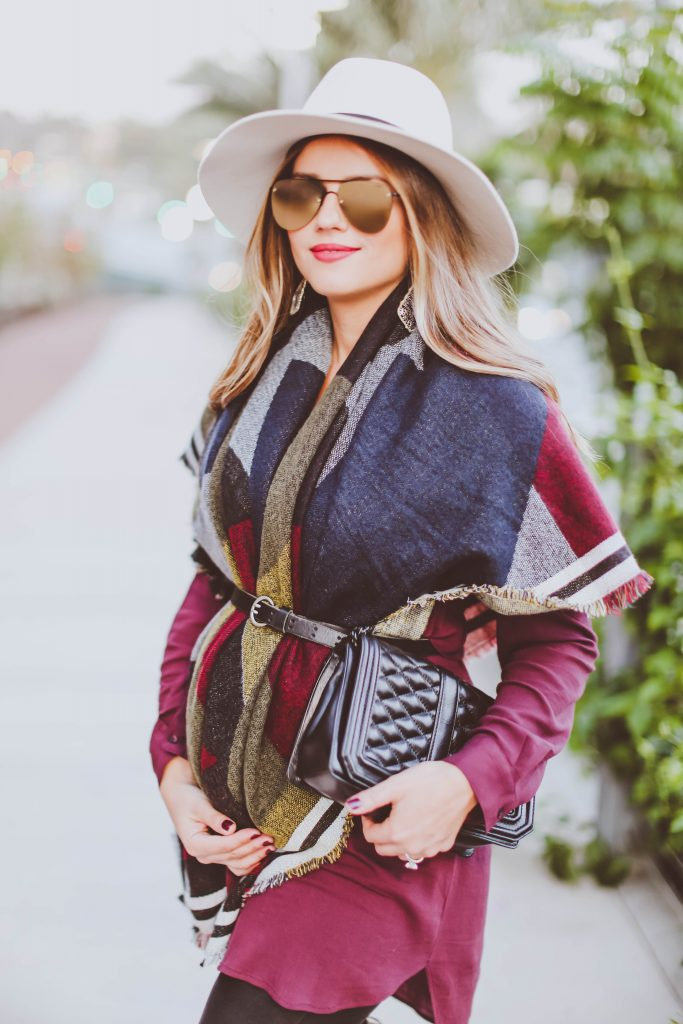 pregnancy style, pregnant, fall maternity outfit, 14 weeks pregnant, blanket scarf, burgundy tunic, spanx leggings, stuart weitzman lowland boots in topo suede, rebecca minkoff love crossbody bag as a clutch, le specs prince, janessa leone white fedora