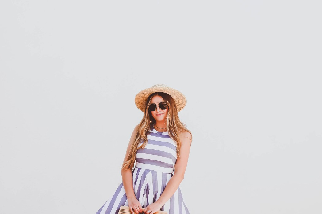 eliza j dresses blue & white halter dress, cult gaia bamboo ark bag, stokke xplory stroller, pearl slides, straw boater hat