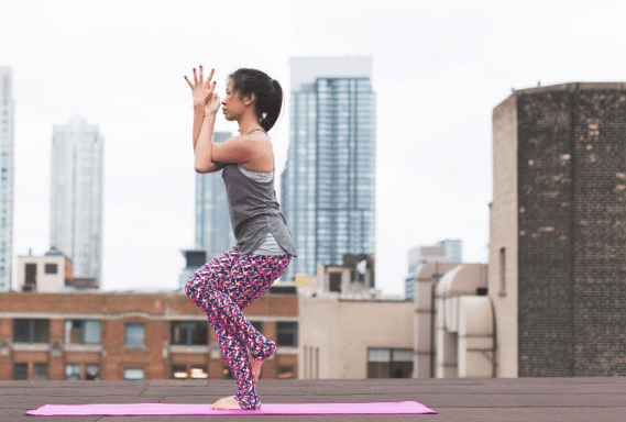 Woman performing Eagle Pose. Image by Burst from Pexels