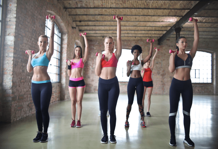 Group of women weight lifting. Image by Bruce Mars from Unsplash.
