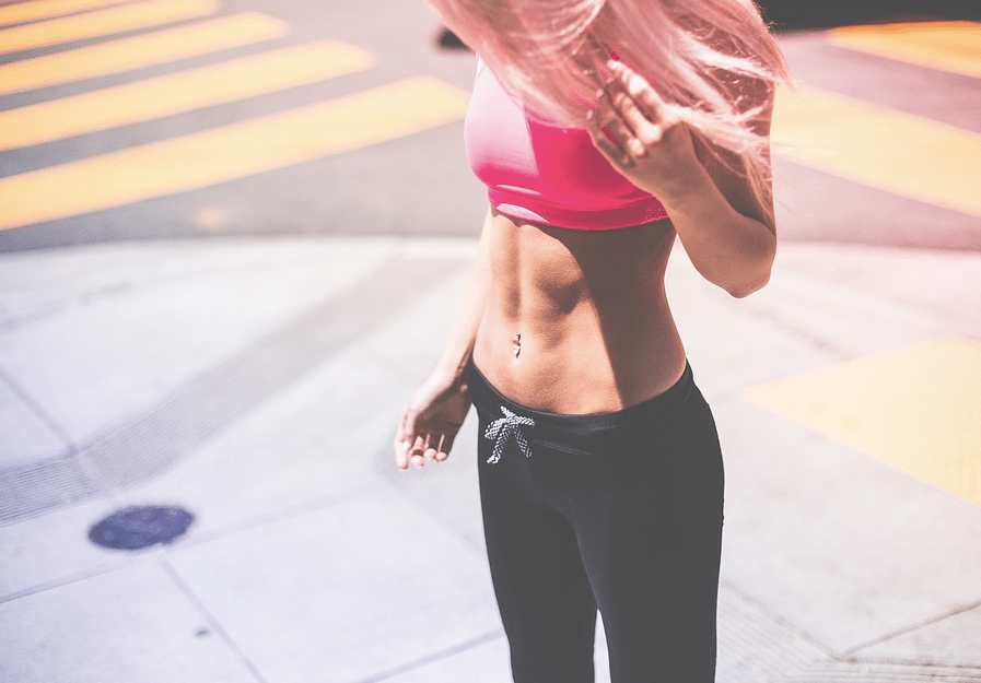 Girl looking down wearing gym gear. Image by Pexels from Pixabay.
