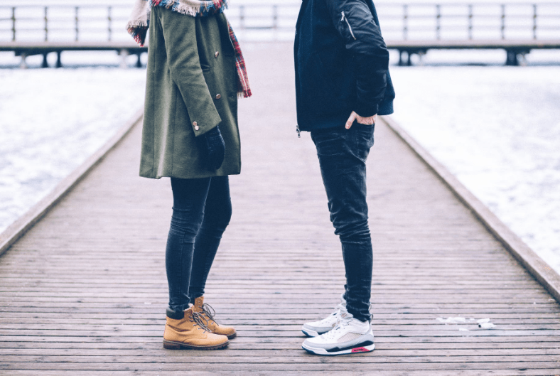 Image of woman and man talking on pier. Image by freestocks.org from Pexels.com
