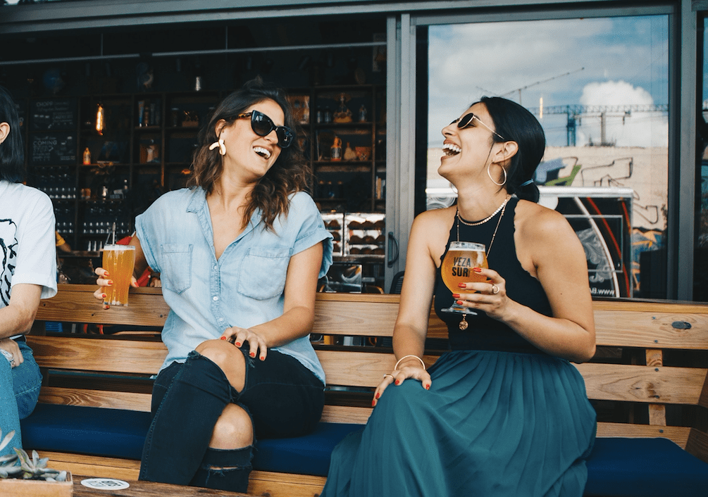 Two friends laughing together. Photo by ELEVATE from Pexels.com
