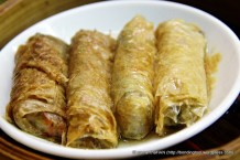 Luohon Zai - vegetable rolled in beanskin wrap.