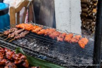Chunky style pork satay and chicken liver on the grill.