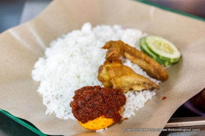 The main attraction of Nasi Lemak is the Coconut Rice and Sambal.