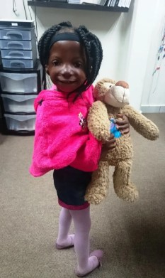 Lebo and her Oticon Medical Massie Monkey