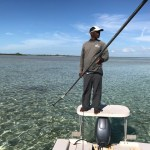 Hermon poling andros guide boat looking for bonefish