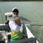fisherhman holding bonefish