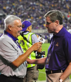 Brian Bailey interviews new ECU Chancellor Dr. Cecil Staton during a break in the action at Saturday night's game. (W.A. Myatt photo)