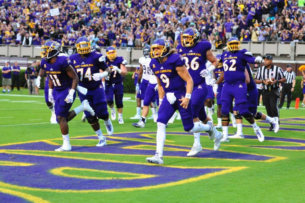Celebration ensues after quarterback Philip Nelson (9) scores the first points of the season for East Carolina. (Bonesville Staff photo)