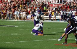 ECU holder Worth Gregory places the ball for a 43-yard field goal by Davis Plowman that pulled the Pirates within 17-6.