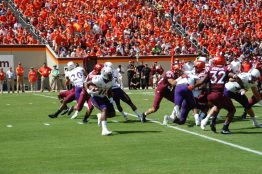 James Summers runs for East Carolina in Saturday's game in Blacksburg, Va. (Photo by Al Myatt)