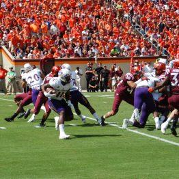 James Summers runs for East Carolina in Saturday's game in Blacksburg, Va. (Photo by Al Myatt)