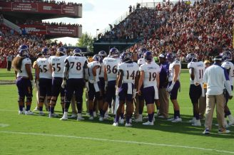 East Carolina's offense gathers for a strategy meeting during a time-out on Saturday in Columbia, SC.