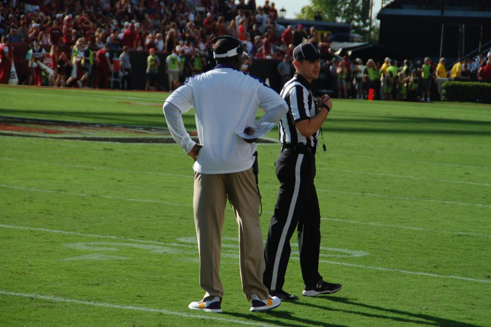ECU first-year coach Scottie Montgomery seeks an explanation after replay showed the ball on the ground on the pick by King.