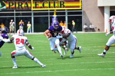 Senior quarterback Philip Nelson sheds two N.C. State defenders as he converts on a key fourth down in ECU's 33-30 win over the Wolfpack on Sept. 10. (WA Myatt photo)