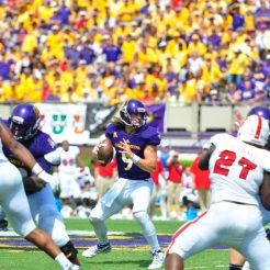 Quarterback Philip Nelson surveys the field against the Wolfpack. The long-haired leader threw for 297 yards, completing 33-43 attempts with one touchdown and 1 interception Saturday. (WA Myatt photo)