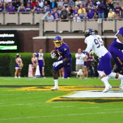 Junior running back Anthony Scott looks to turn the corner against the Catamounts. The Virginia product rushed for 120 yards on 11 carries in a 52-7 win. (W.A. Myatt photo)