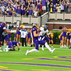Senior quarterback Philip Nelson strides into the end zone for his first touchdown in a Pirate uniform. (W.A. Myatt photo)