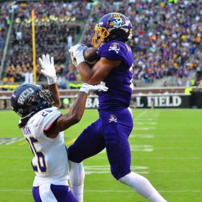 Wide receiver Quay Johnson rises above WCU defensive back Trey Morgan to haul in a touchdown pass from Philip Nelson. (Bonesville Staff photo)